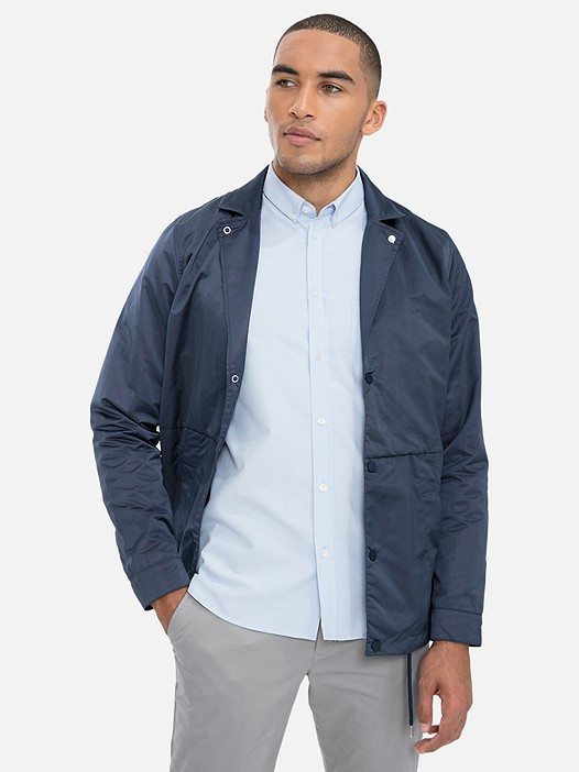 ODYSS V1.Y3.01 Coach Jacket with Back Print blue Model shot Alpha Tauri